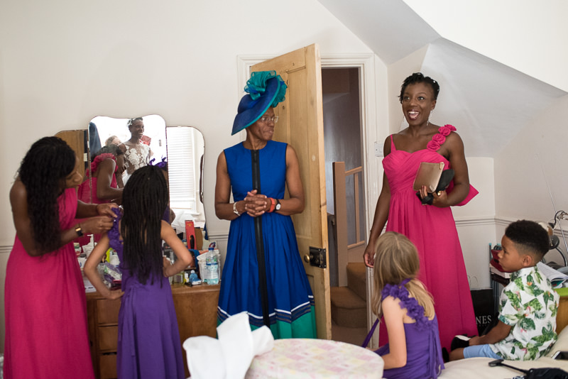 Bride getting ready in family home for outdoor wedding