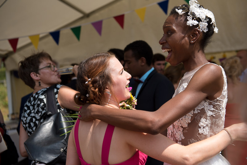 Bride mingles with guests at outdoor wedding