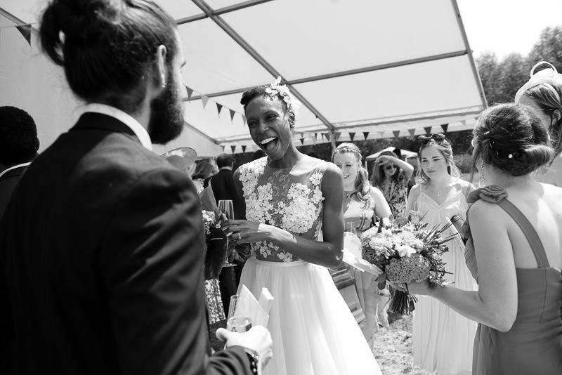 Bride greets guests at outdoor wedding