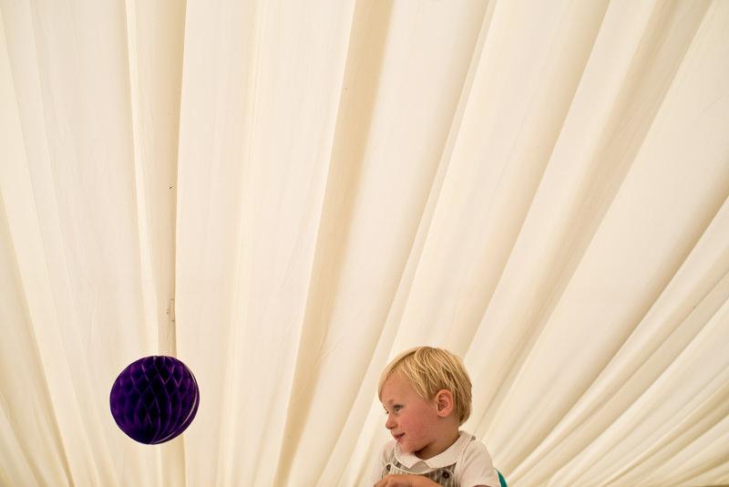 Child on dancefloor at marquee wedding