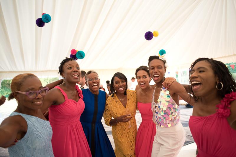 Black bride on dancefloor at marquee outdoor wedding