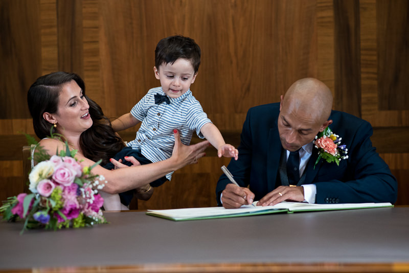 Bride and groom with toddler sign register at Stoke Newington Town Hall