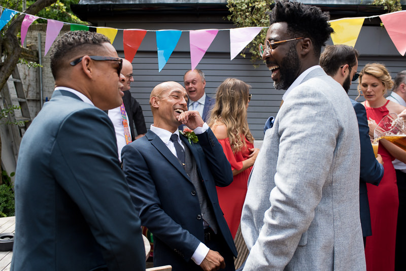 Groom mingling with guests at the Londesborough pub Stoke Newington