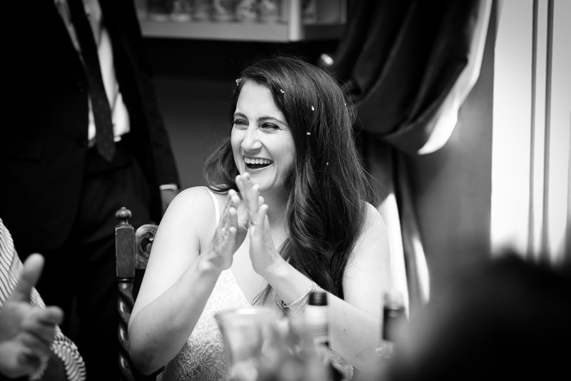 Bride laughing at speeches at Stoke Newington Pub Wedding
