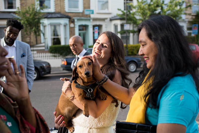 Bride with sausage dog at Stoke Newington Pub wedding