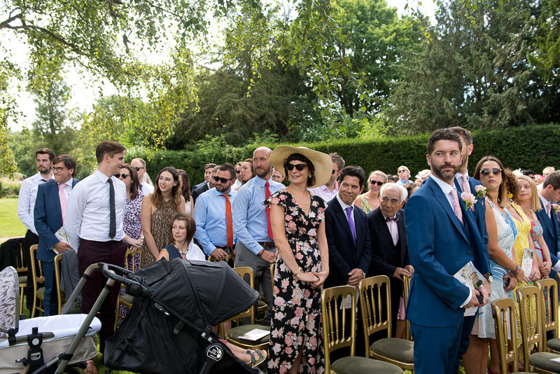 Guests awaiting bride at Chiddingstone Castle wedding