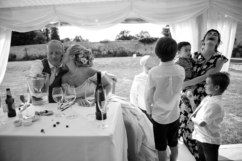 Bride and groom in marquee at Chiddingstone Castle wedding