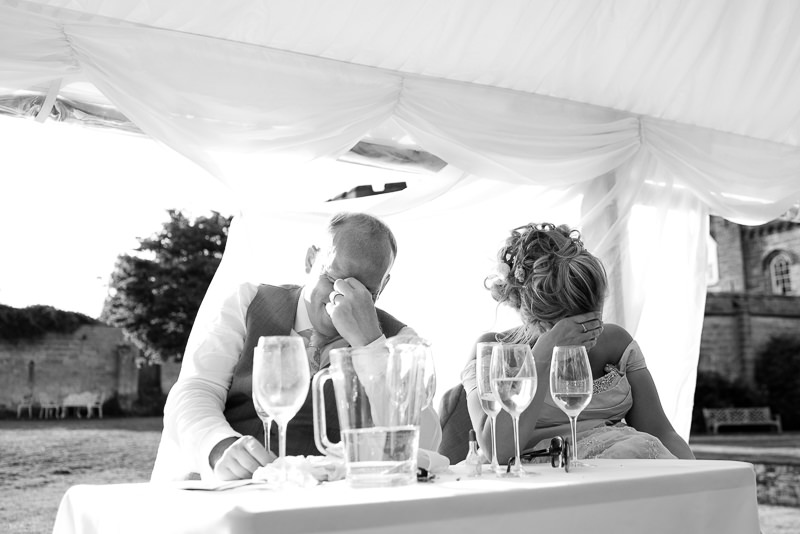 Bride and groom react to speeches at Chiddingstone Castle