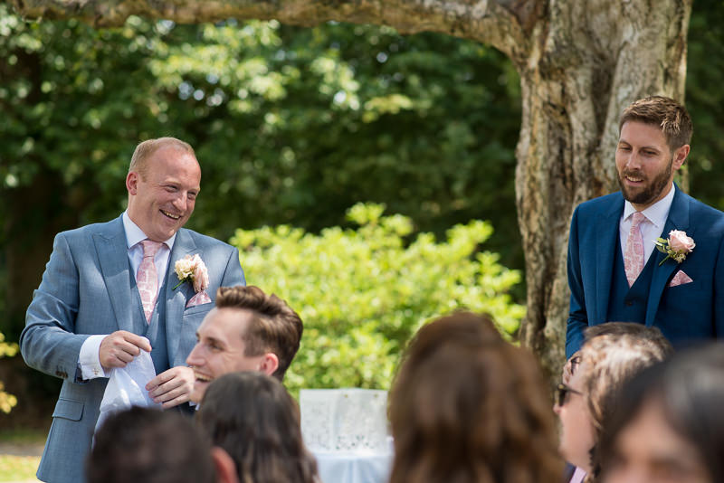 Groom mingles with guests before the ceremony at Chiddingstone Castle