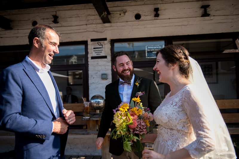 Bride and groom mingle with guests at Holburn Studios wedding