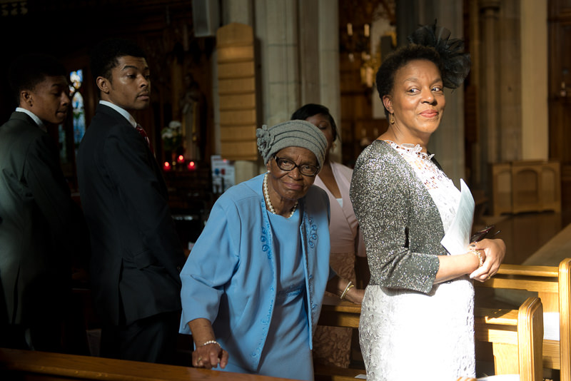Guests watch bride enter church