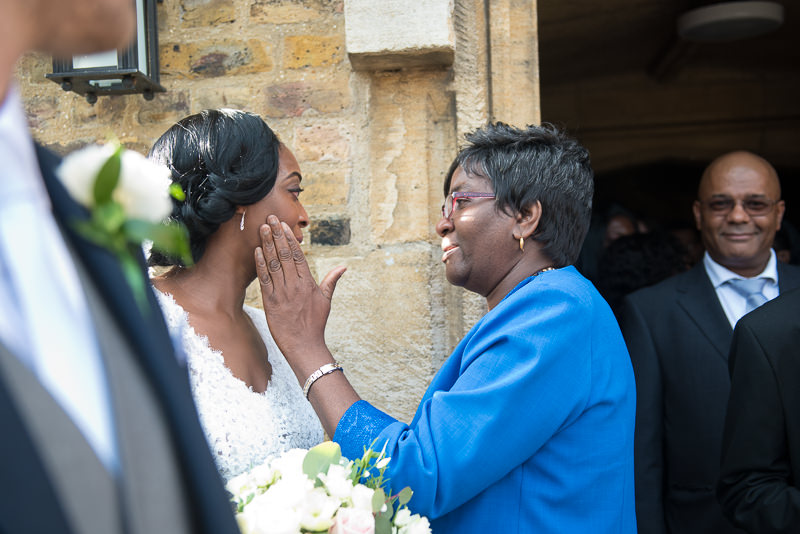 Bride greets guests before Amadeus Centre wedding