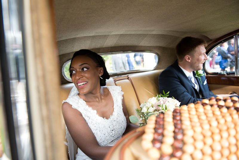 Bride and groom in Rolls Royce at Amadeus Centre