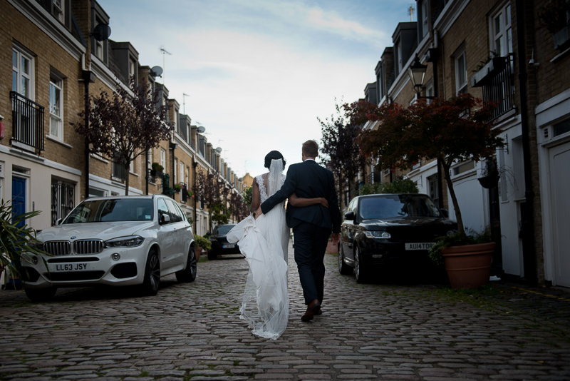 Bride and groom on cobbled streets near Amadeus Centre