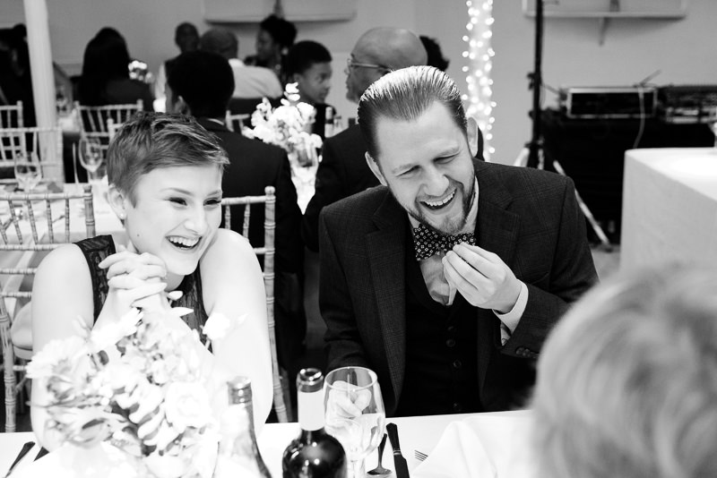 Guests laughing at Amadeus Centre wedding