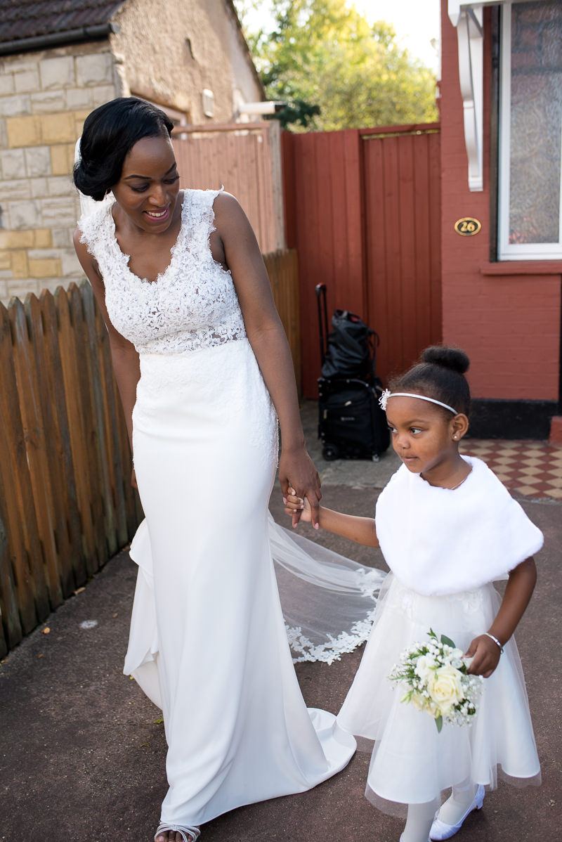 Black bride with flower girl