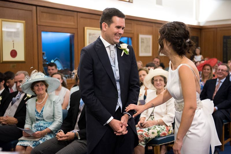 Bride and groom laugh during HQS Wellington wedding