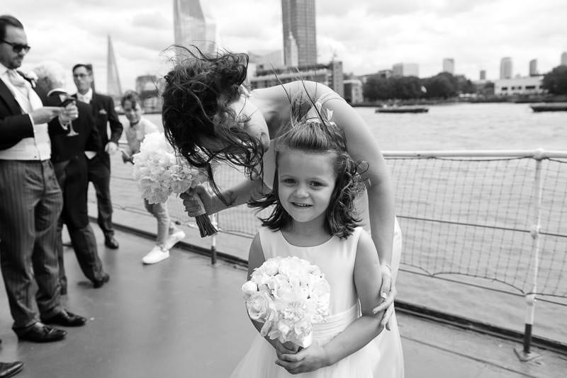 Bride with flower girl on HQS wellington