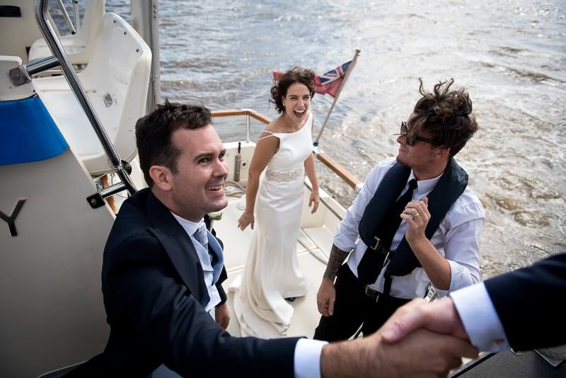 Bride and groom leave ship after HQS Wellington wedding