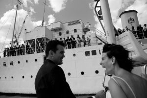 Bride and groom get water taxi after getting married on the HQS Wellington