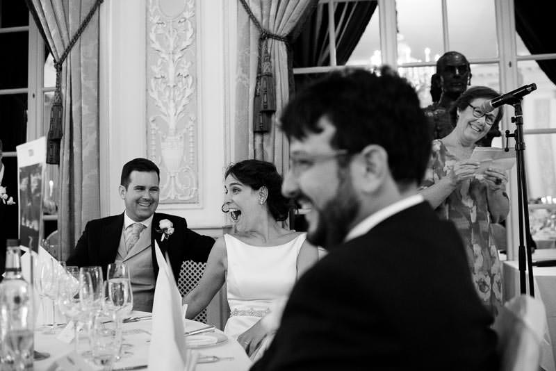 Bride and groom listen to speeches at RAC wedding