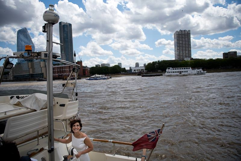 Bride arrives in water taxi for HQS wellington wedding