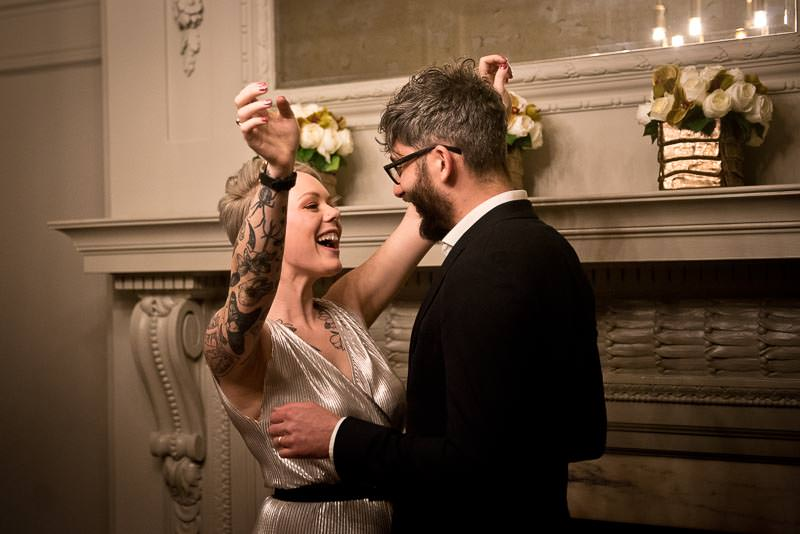 Winter wedding at Marylebone Town Hall with bride in jumpsuit