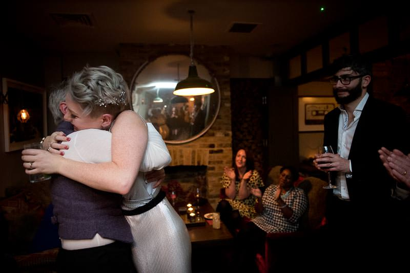 Bride hugs Mum at Cambridge Kitchen wedding