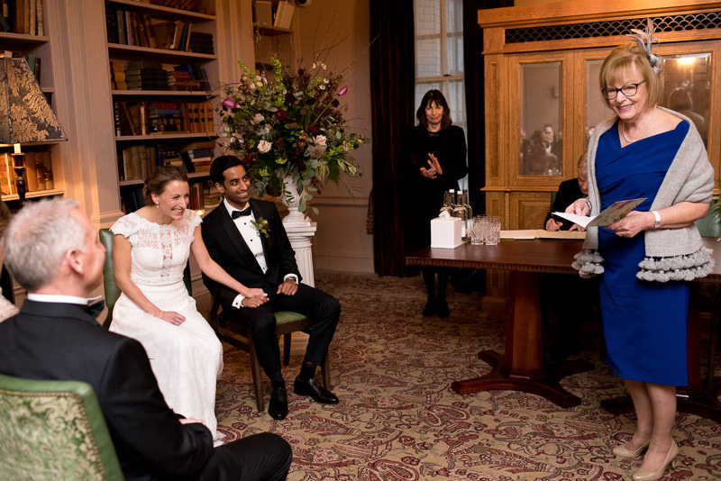 Bride and groom listen to reading during wedding ceremony at The Ned hotel