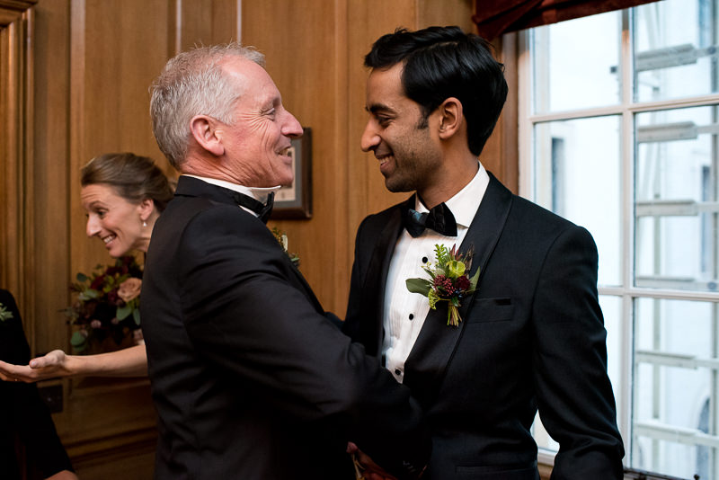 Groom greets father of the bride at The Ned hotel wedding