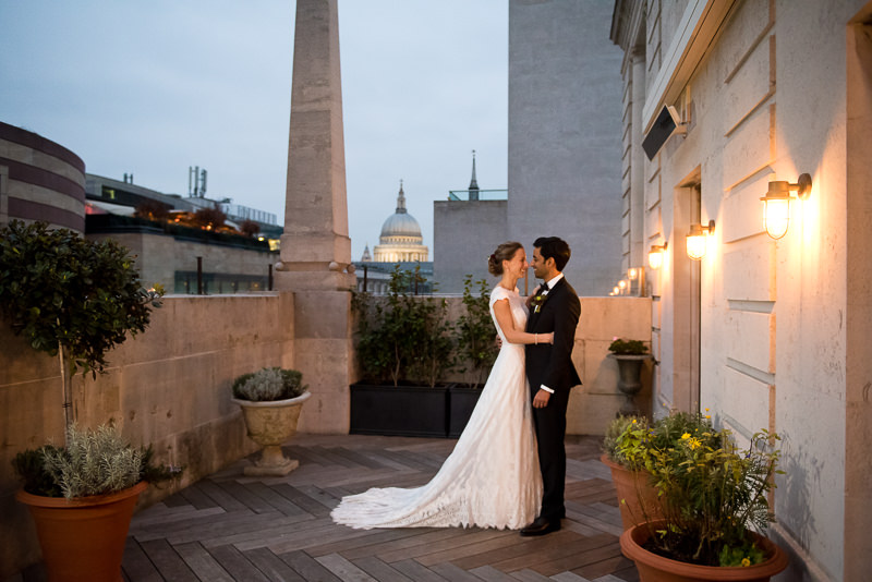 Bride and groom on terrace at The Ned Hotel