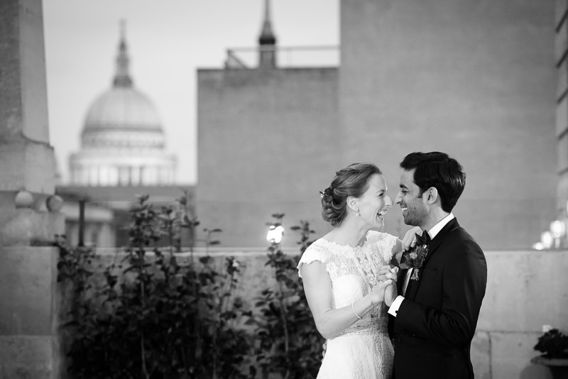 Portrait of bride and groom with St Pauls Cathedral at London wedding
