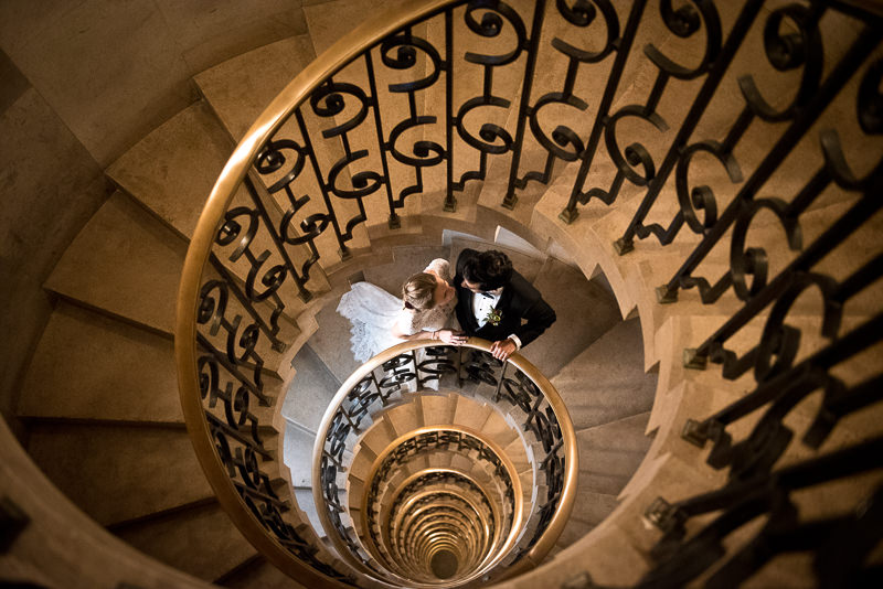 Bride and groom portrait on staircase at The Ned Hotel