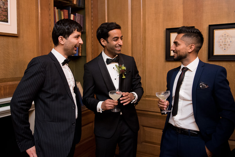 Groom mingles with guests at The Ned Hotel wedding