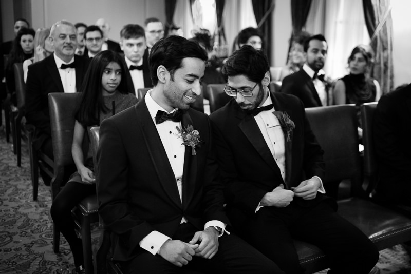 Groom and best man waiting for bride at The Ned hotel wedding ceremony