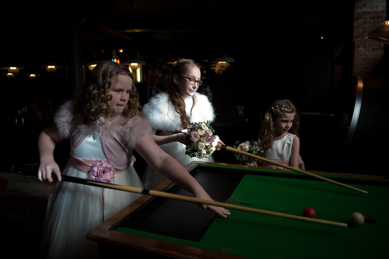 Flower girls play pool at Hixter wedding