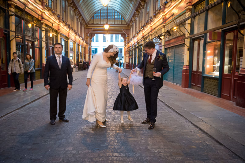 Bride and groom with flower girl at Leadenhall market wedding