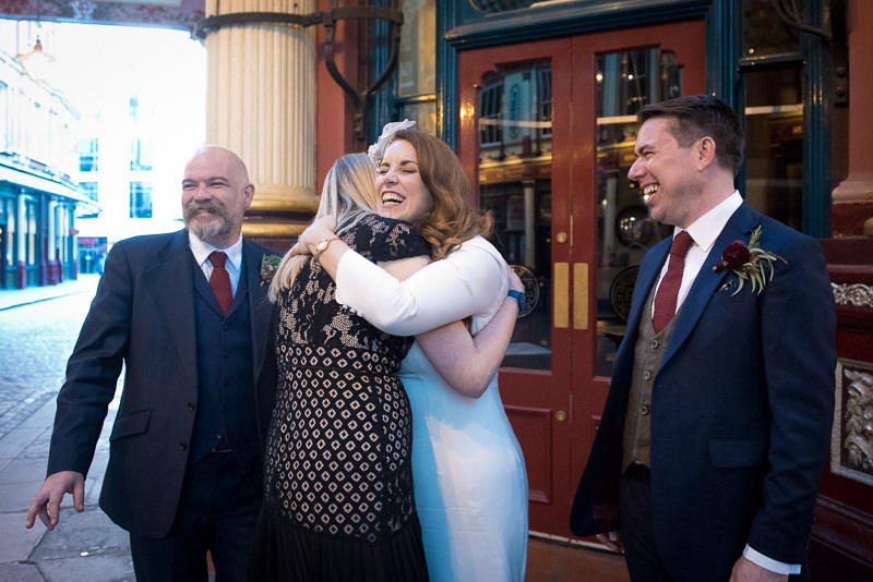 Bride greets guests at Leadenhall Market wedding