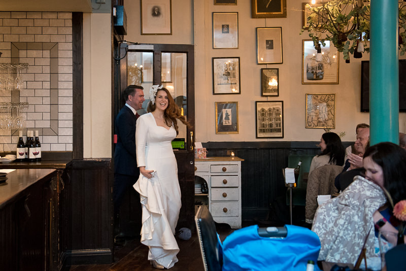 Bride and groom arrive at wedding breakfast at the Lamb Tavern