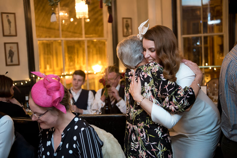 Bride hugs guest at Lamb Tavern wedding