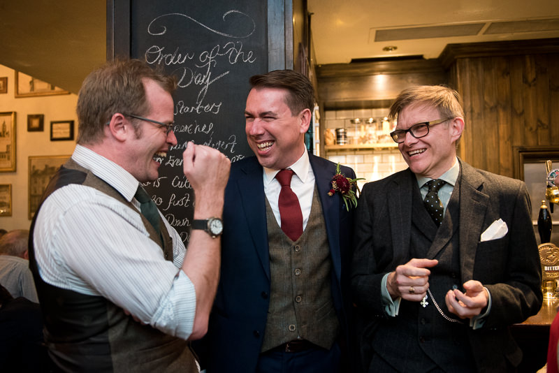Groom mingles with friends at Leadenhall Market wedding