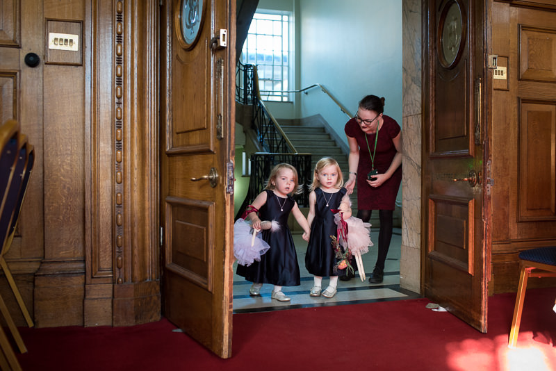 Flower girls walk down the aisle at Islington Town Hall