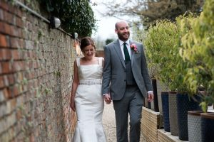 Bride and groom in garden at Kings Chapel