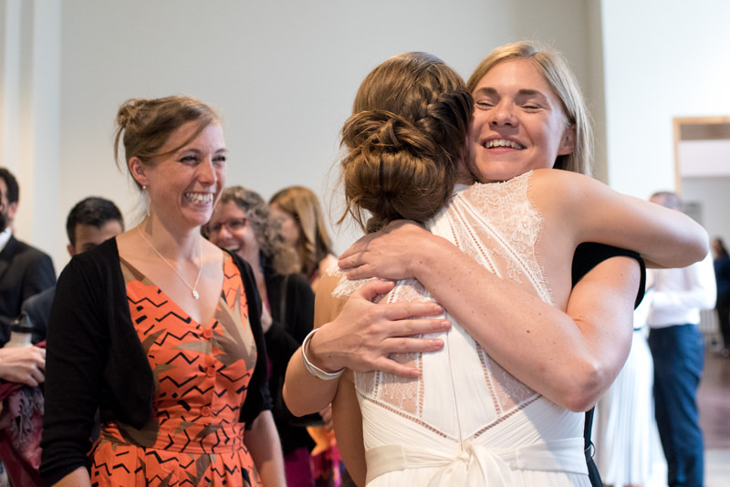 Bride hugs friend at QMUL wedding