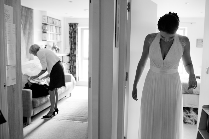 Black and white photograph of bride preparations