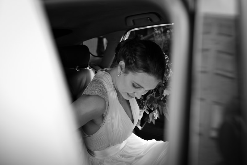 Black and white photograph of London bride in car