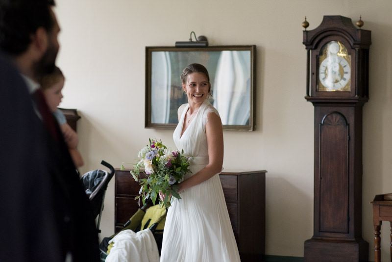 Bride enters room for wedding ceremony at Queen Mary University