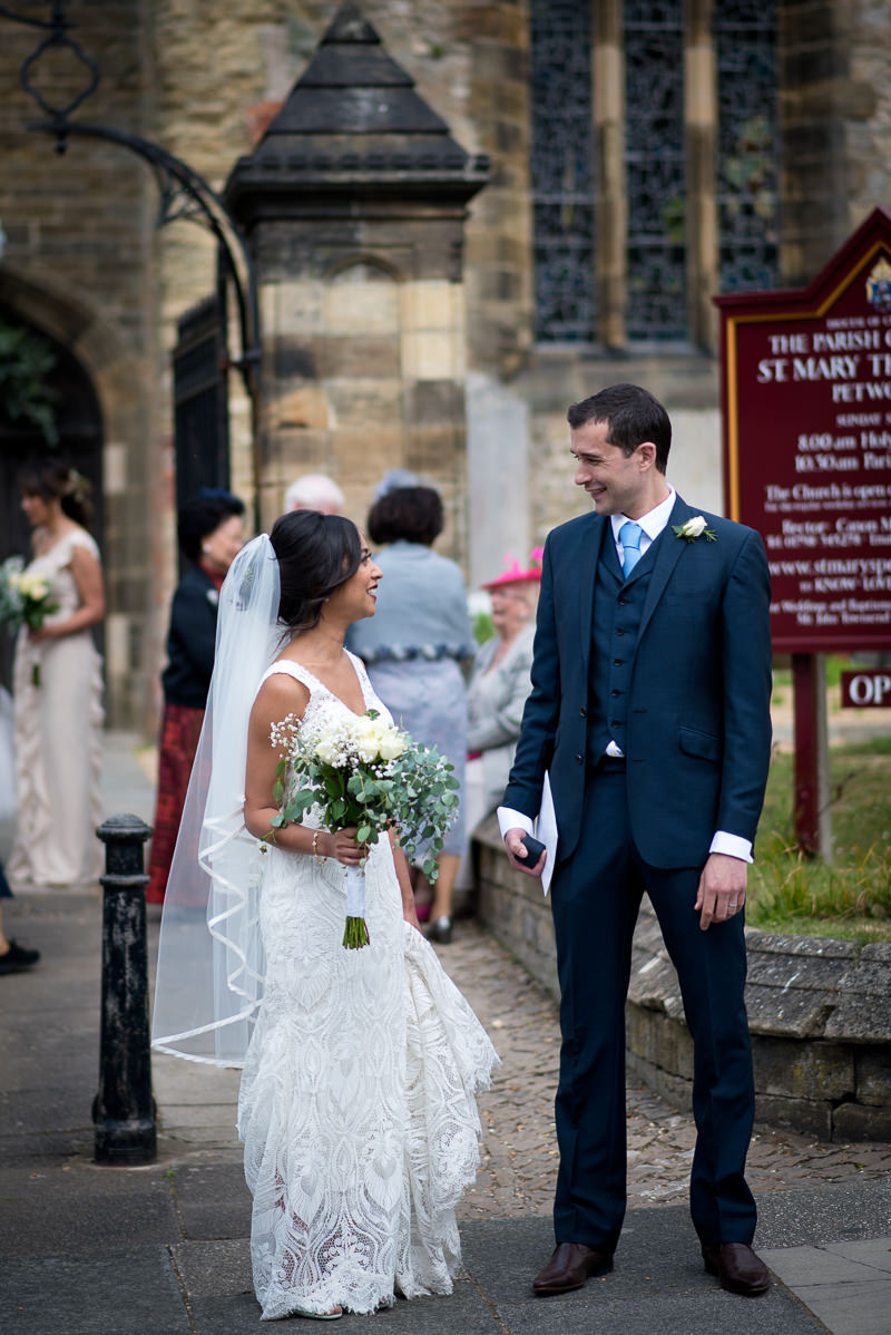 Bride and groom outside church in Petworth
