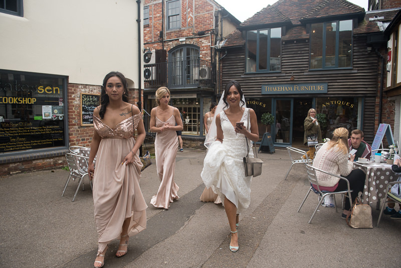 Bride walks through Petworth to church wedding