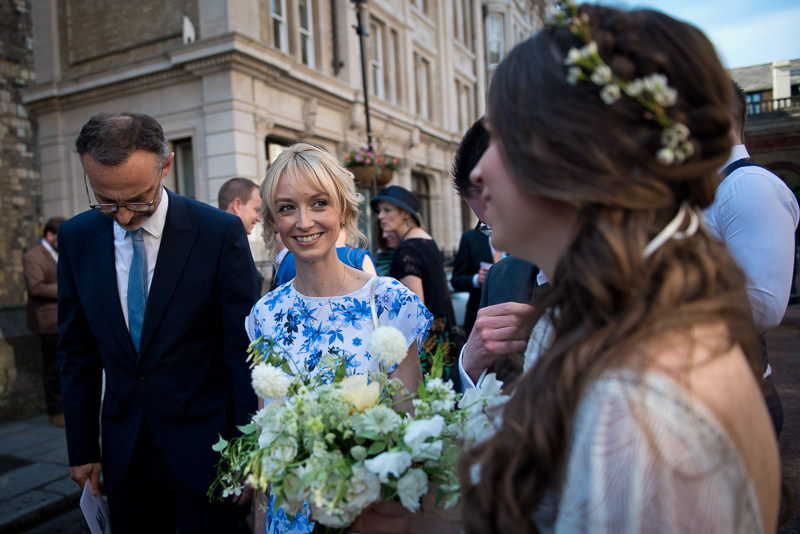 Guests greet couple at St Etheldreda wedding